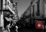 Image of Narrow crowded commercial street Puerto Rico, 1950, second 23 stock footage video 65675043413
