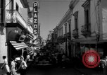 Image of Narrow crowded commercial street Puerto Rico, 1950, second 24 stock footage video 65675043413