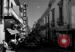 Image of Narrow crowded commercial street Puerto Rico, 1950, second 25 stock footage video 65675043413