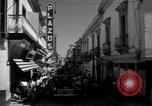 Image of Narrow crowded commercial street Puerto Rico, 1950, second 26 stock footage video 65675043413