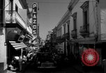 Image of Narrow crowded commercial street Puerto Rico, 1950, second 27 stock footage video 65675043413
