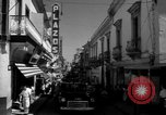 Image of Narrow crowded commercial street Puerto Rico, 1950, second 28 stock footage video 65675043413