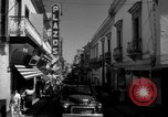 Image of Narrow crowded commercial street Puerto Rico, 1950, second 29 stock footage video 65675043413