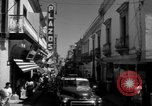 Image of Narrow crowded commercial street Puerto Rico, 1950, second 30 stock footage video 65675043413