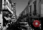 Image of Narrow crowded commercial street Puerto Rico, 1950, second 31 stock footage video 65675043413