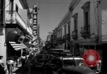 Image of Narrow crowded commercial street Puerto Rico, 1950, second 32 stock footage video 65675043413