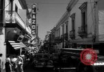 Image of Narrow crowded commercial street Puerto Rico, 1950, second 33 stock footage video 65675043413