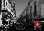 Image of Narrow crowded commercial street Puerto Rico, 1950, second 34 stock footage video 65675043413