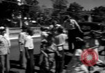 Image of Narrow crowded commercial street Puerto Rico, 1950, second 36 stock footage video 65675043413
