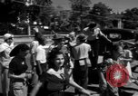 Image of Narrow crowded commercial street Puerto Rico, 1950, second 37 stock footage video 65675043413