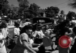 Image of Narrow crowded commercial street Puerto Rico, 1950, second 39 stock footage video 65675043413