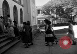 Image of Narrow crowded commercial street Puerto Rico, 1950, second 40 stock footage video 65675043413
