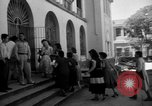Image of Narrow crowded commercial street Puerto Rico, 1950, second 41 stock footage video 65675043413