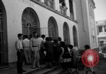 Image of Narrow crowded commercial street Puerto Rico, 1950, second 42 stock footage video 65675043413