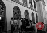 Image of Narrow crowded commercial street Puerto Rico, 1950, second 43 stock footage video 65675043413
