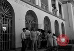 Image of Narrow crowded commercial street Puerto Rico, 1950, second 45 stock footage video 65675043413