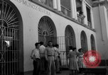 Image of Narrow crowded commercial street Puerto Rico, 1950, second 46 stock footage video 65675043413