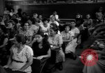 Image of Narrow crowded commercial street Puerto Rico, 1950, second 55 stock footage video 65675043413