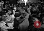 Image of Narrow crowded commercial street Puerto Rico, 1950, second 58 stock footage video 65675043413