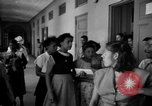 Image of Narrow crowded commercial street Puerto Rico, 1950, second 60 stock footage video 65675043413