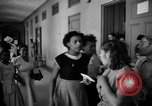 Image of Narrow crowded commercial street Puerto Rico, 1950, second 61 stock footage video 65675043413