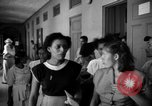 Image of Narrow crowded commercial street Puerto Rico, 1950, second 62 stock footage video 65675043413