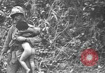 Image of American soldiers and marines battle Japanese forces in Okinawa Okinawa Ryukyu Islands, 1945, second 38 stock footage video 65675043441