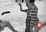 Image of bathers swim in icy water Oregon Mount Hood USA, 1938, second 20 stock footage video 65675043530