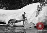 Image of bathers swim in icy water Oregon Mount Hood USA, 1938, second 34 stock footage video 65675043530