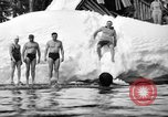 Image of bathers swim in icy water Oregon Mount Hood USA, 1938, second 39 stock footage video 65675043530