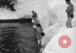 Image of bathers swim in icy water Oregon Mount Hood USA, 1938, second 49 stock footage video 65675043530