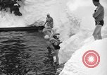 Image of bathers swim in icy water Oregon Mount Hood USA, 1938, second 50 stock footage video 65675043530