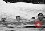 Image of bathers swim in icy water Oregon Mount Hood USA, 1938, second 52 stock footage video 65675043530