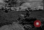 Image of man with container on his back Caracas Venezuela, 1940, second 4 stock footage video 65675050648