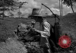 Image of man with container on his back Caracas Venezuela, 1940, second 15 stock footage video 65675050648