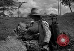 Image of man with container on his back Caracas Venezuela, 1940, second 16 stock footage video 65675050648