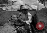 Image of man with container on his back Caracas Venezuela, 1940, second 17 stock footage video 65675050648