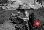 Image of man with container on his back Caracas Venezuela, 1940, second 21 stock footage video 65675050648