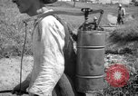 Image of man with container on his back Caracas Venezuela, 1940, second 24 stock footage video 65675050648