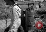 Image of man with container on his back Caracas Venezuela, 1940, second 25 stock footage video 65675050648