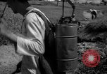 Image of man with container on his back Caracas Venezuela, 1940, second 27 stock footage video 65675050648
