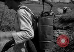 Image of man with container on his back Caracas Venezuela, 1940, second 30 stock footage video 65675050648