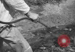 Image of man with container on his back Caracas Venezuela, 1940, second 36 stock footage video 65675050648