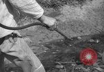 Image of man with container on his back Caracas Venezuela, 1940, second 37 stock footage video 65675050648