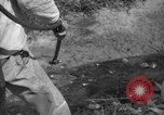 Image of man with container on his back Caracas Venezuela, 1940, second 40 stock footage video 65675050648