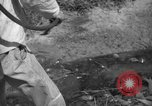 Image of man with container on his back Caracas Venezuela, 1940, second 43 stock footage video 65675050648