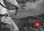 Image of man with container on his back Caracas Venezuela, 1940, second 45 stock footage video 65675050648