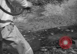 Image of man with container on his back Caracas Venezuela, 1940, second 46 stock footage video 65675050648
