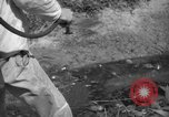 Image of man with container on his back Caracas Venezuela, 1940, second 47 stock footage video 65675050648