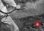 Image of man with container on his back Caracas Venezuela, 1940, second 49 stock footage video 65675050648